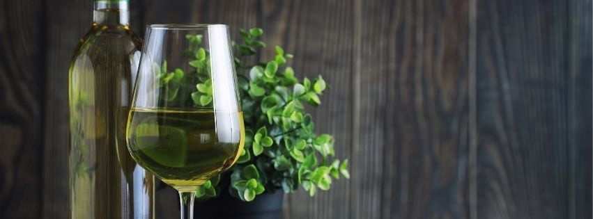 Dry white wine bottle and glass